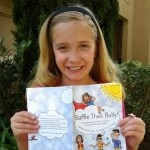 10-Year-Old Chase Anichini, Co-Author of Baffle That Bully, holding her book