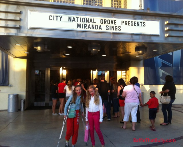 Photo of girls in character outside of Miranda Sings concert.